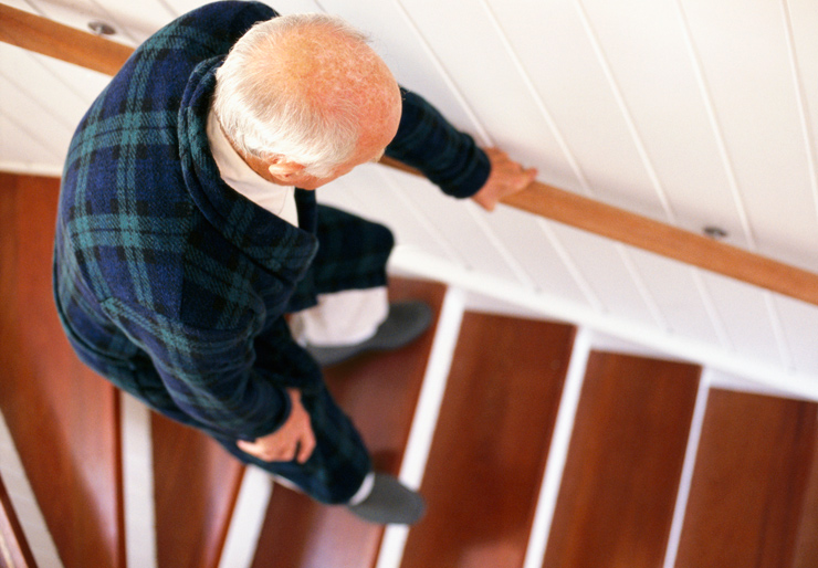 Old man walking down stairs