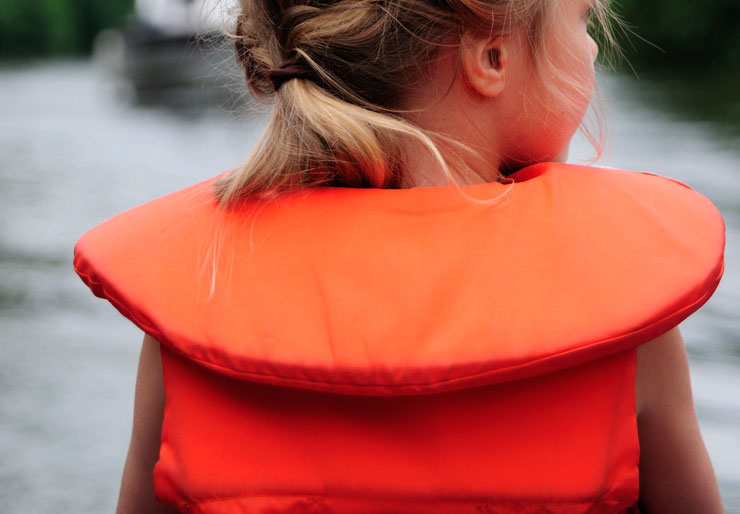 Young girl with orange life jacket
